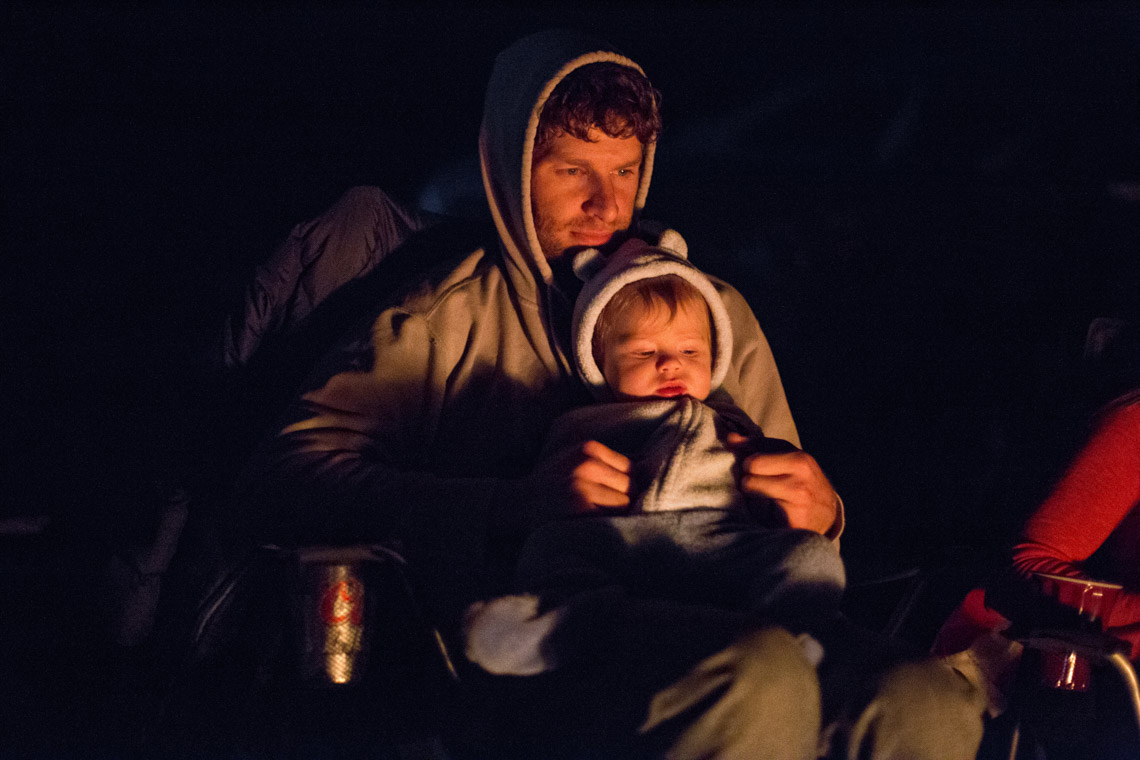 Father and Son by Camp fire